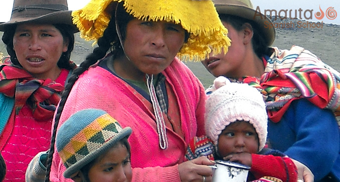 A Peruvian Family In Traditional Clothing Enjoy Hot Chocolate
